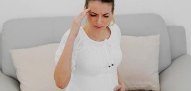 Головные боли во время беременности: причины и лечение